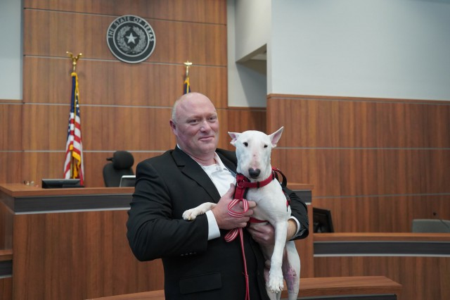 Officer Schultz Adopts Champ